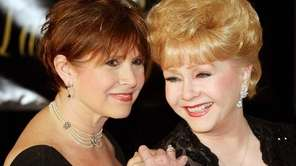 Carrie Fisher, left, and her mother Debbie Reynolds