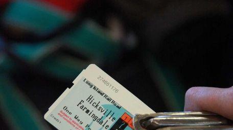 Long Island Rail Road conductor Joy Harris punches