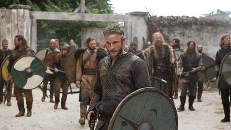 Ragnar Lothbrok (Travis Fimmel), center, prepares to lead