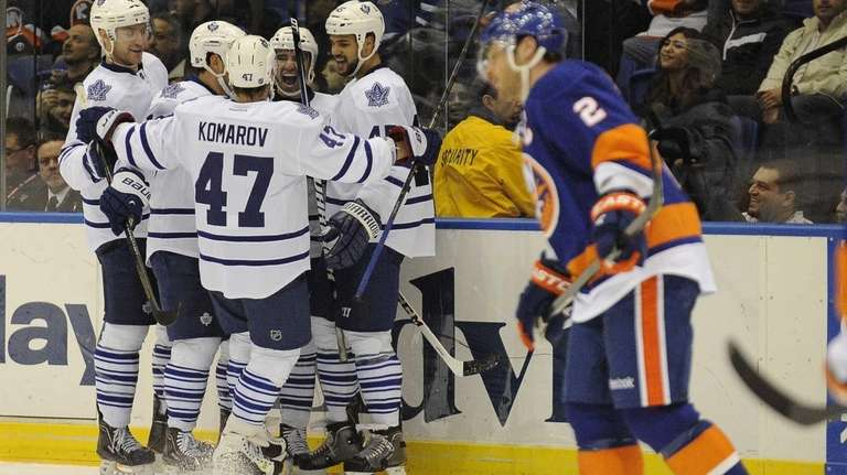 The Toronto Maple Leafs celebrate a goal in