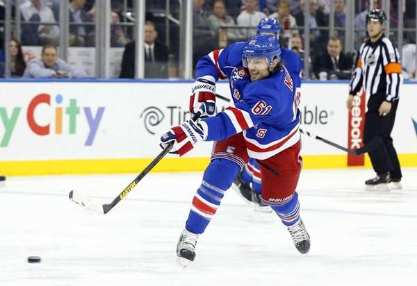 Rick Nash of the Rangers shoots the puck
