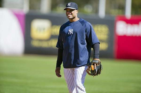 Robinson Cano smiles on the field during his