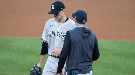 Yankees starting pitcher James Paxton, left, is relieved