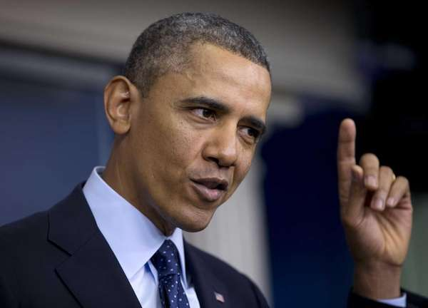 President Barack Obama gestures as he speaks to