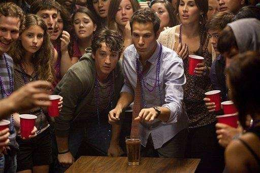 Miles Teller, center left, and Skylar Astin in