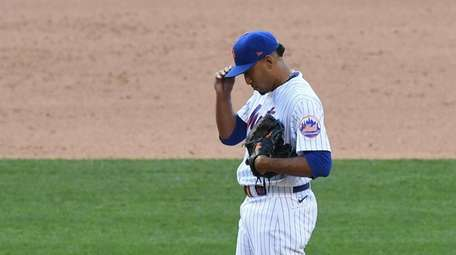 Mets relief pitcher Edwin Diaz stands on the
