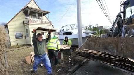Nick Moligano helps a cleanup crew remove debris