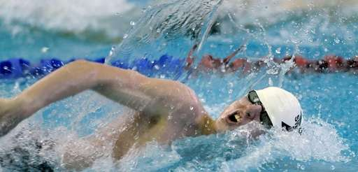Half Hollow Hills' James Gordin swims in the