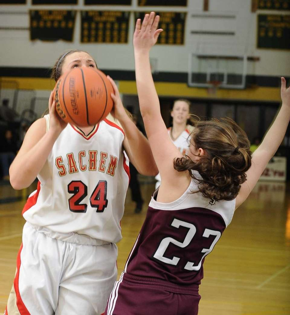 Sachem East's Emily Carmel shoots from under the