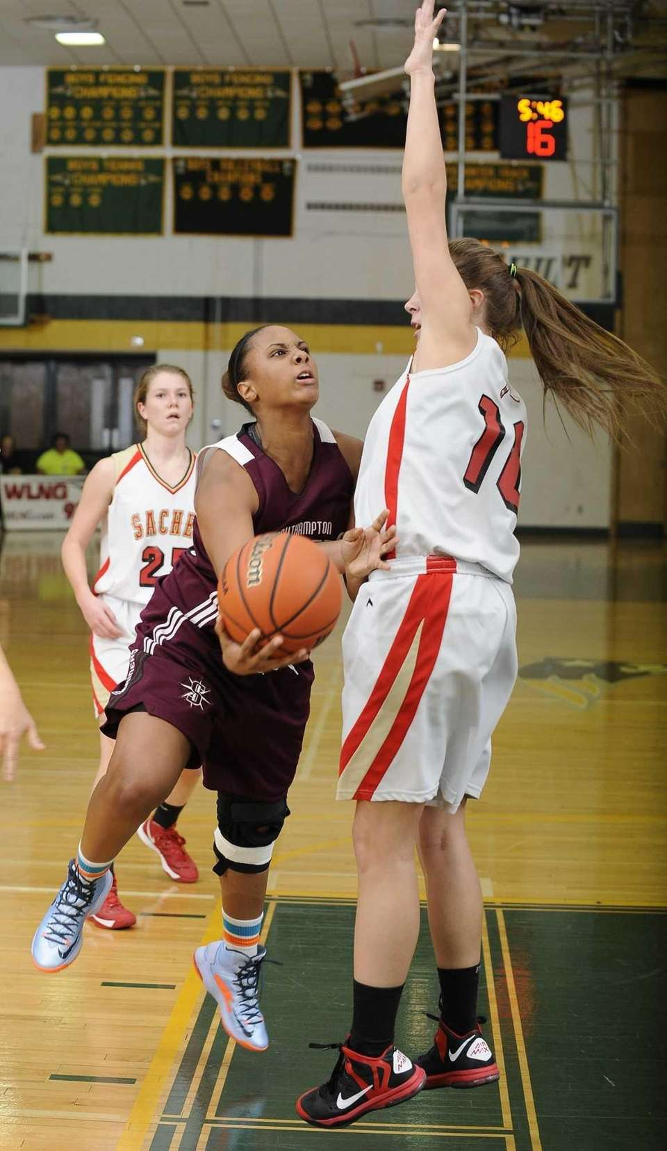 Southampton's Kesi Goree draws a foul against Sachem