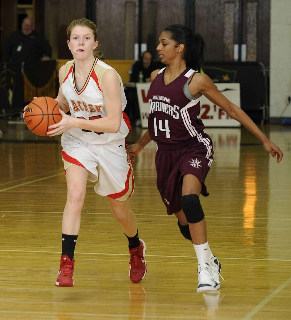Sachem East's Katie Doherty dribbles the ball guarded