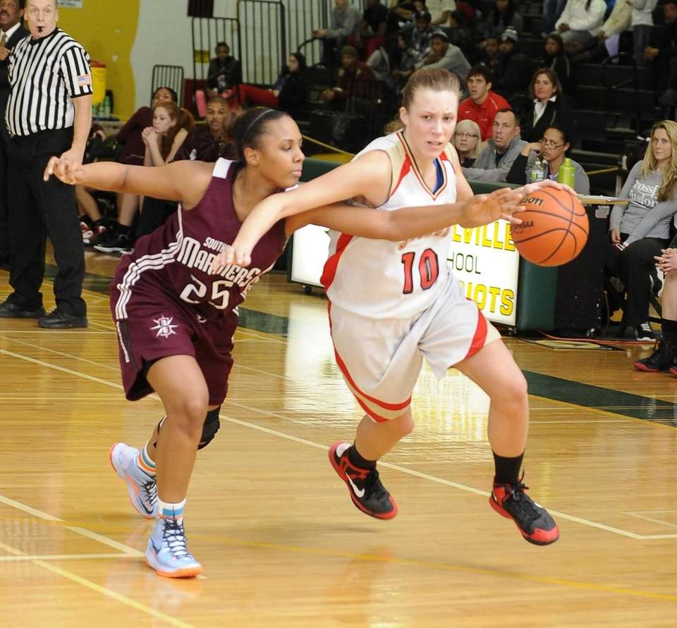 Sachem East's Kathleen Everson drives the ball guarded