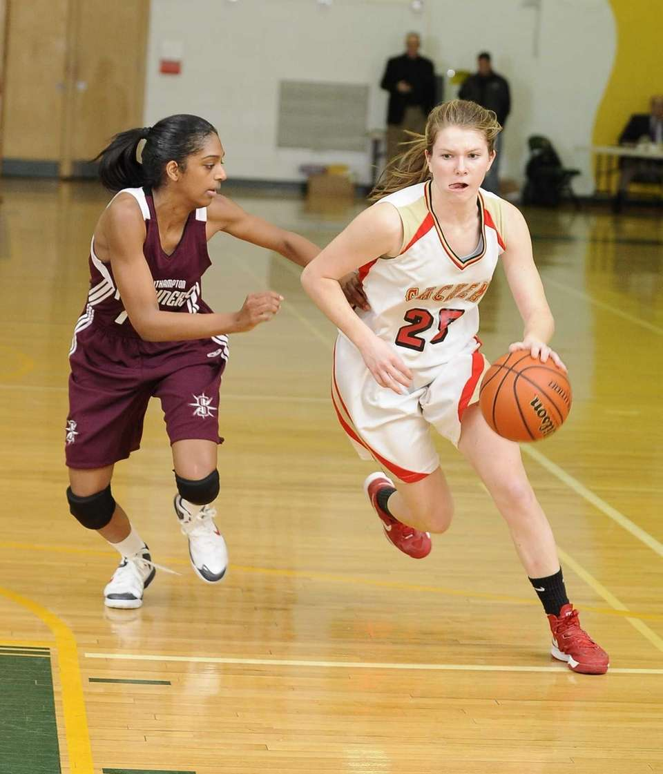 Sachem East's Katie Doherty drives the ball guarded