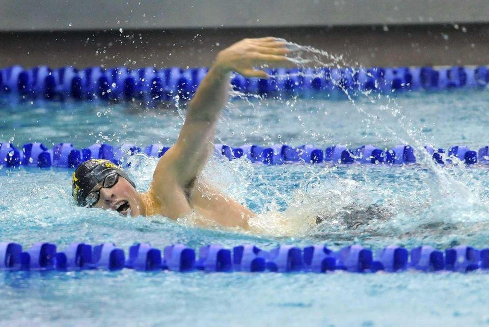 Chaminade's Dan Lagalante swims in the preliminaries of