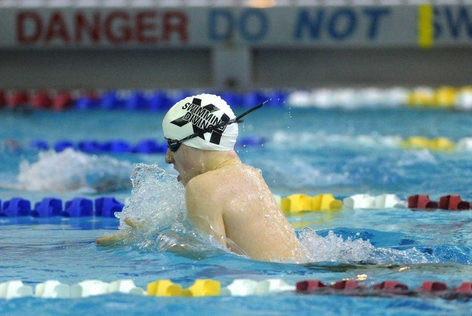 Huntington's Thomas Scott swims in the preliminaries of