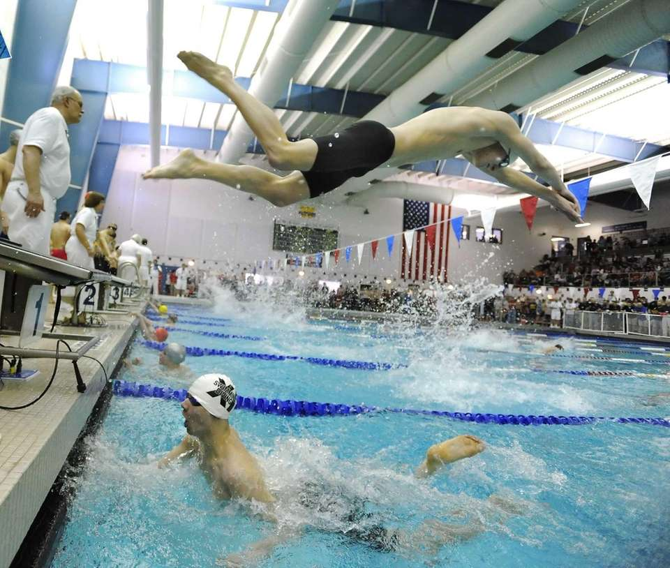 Sachem North's Greg Coleman, top, dives over teammate