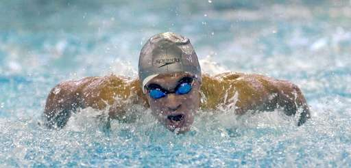 Hauppauge's Justin Plaschka swims in the preliminaries of
