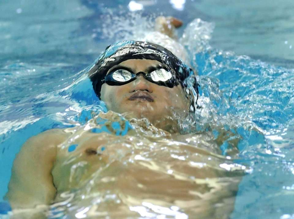 Great Neck South's Daniel Mo swims in the