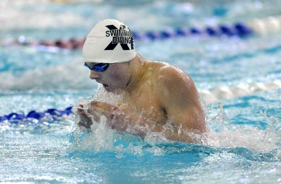 Huntington's Gunther Cassell swims in the preliminaries of
