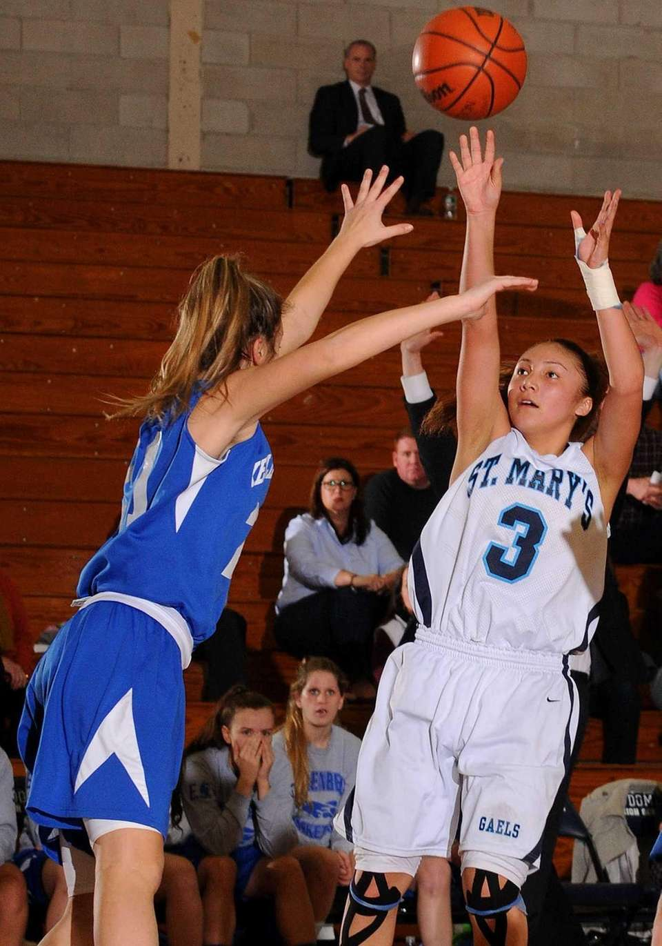 St. Mary's Mei-Lyn Bautista, right, shoots a jumper