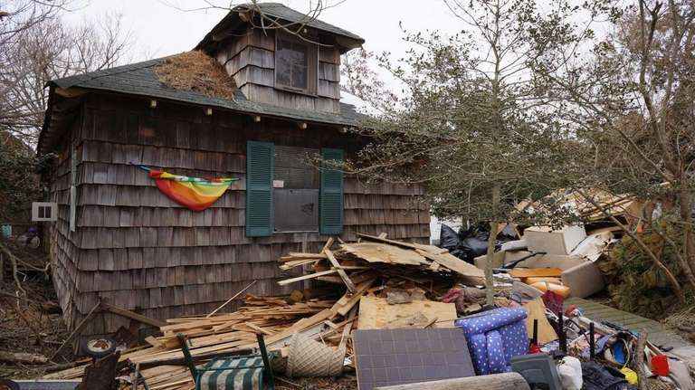 Debris from superstorm Sandy sits in front of