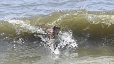 Jeff Bracy, 12, of East Northport, cools off