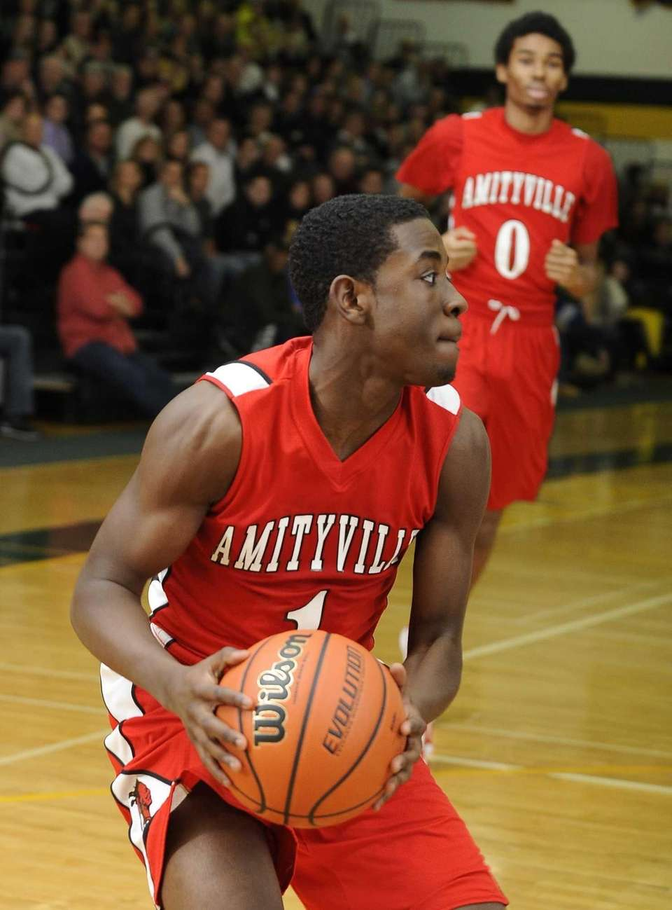 Amityville's Andy Laurent looks to pass against Northport