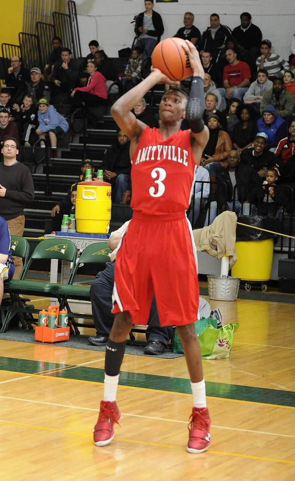 Amityville's Travis Dickerson shoots against Northport in the