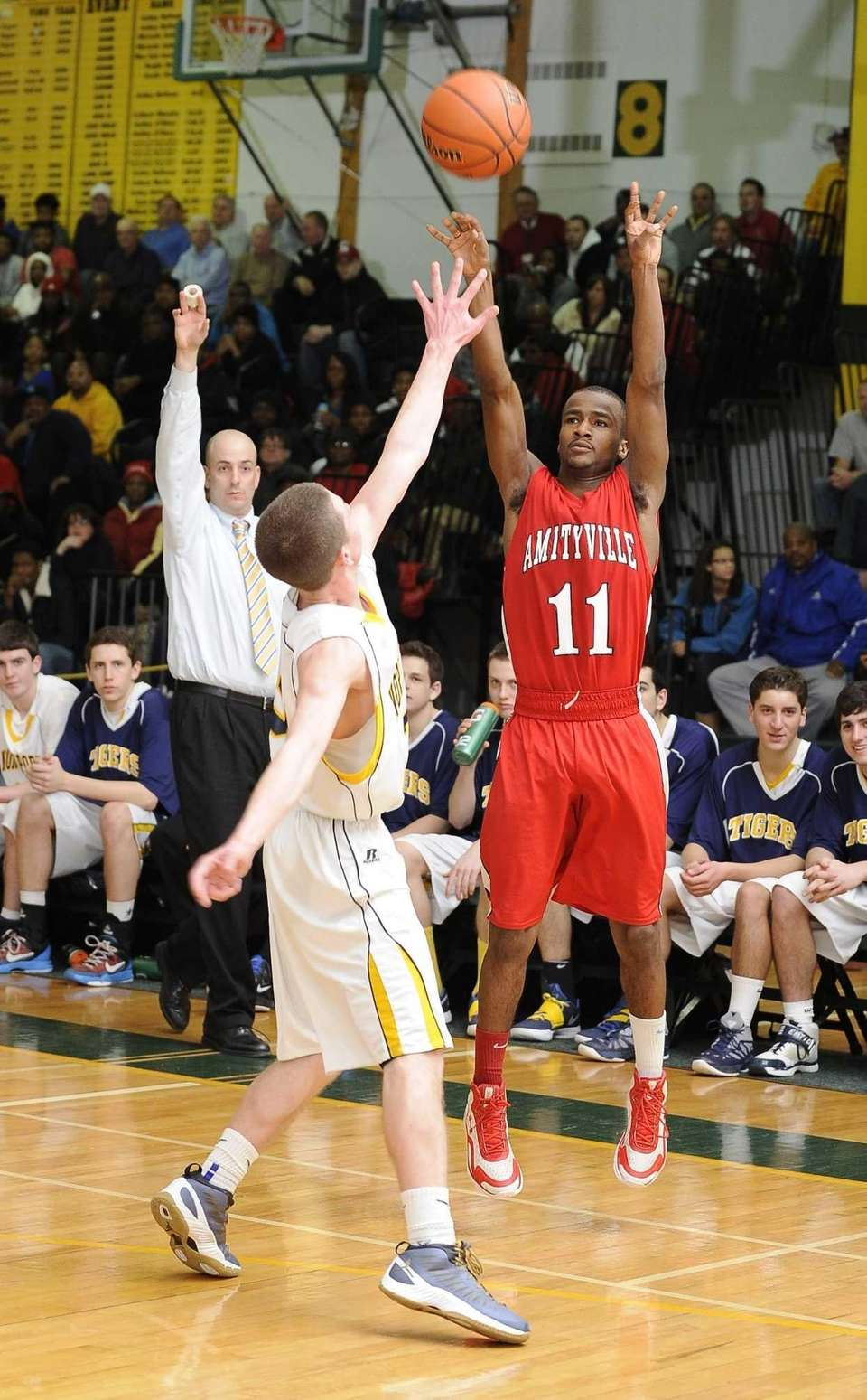 Amityville's Sean Walters shoots a jump shot against