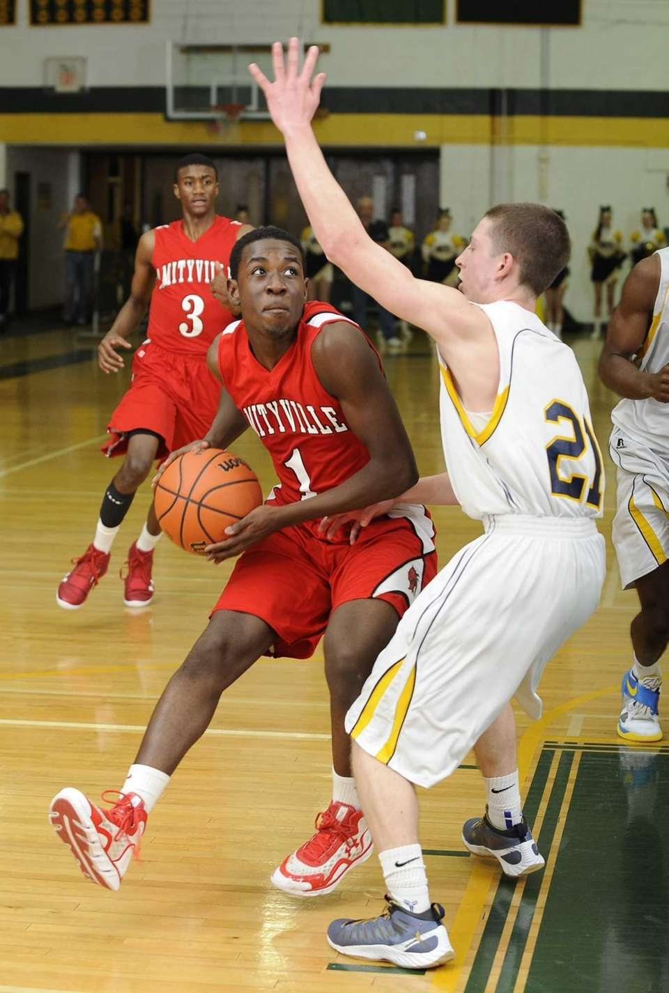 Amityville's Andy Laurent looks to shoot past Northport's