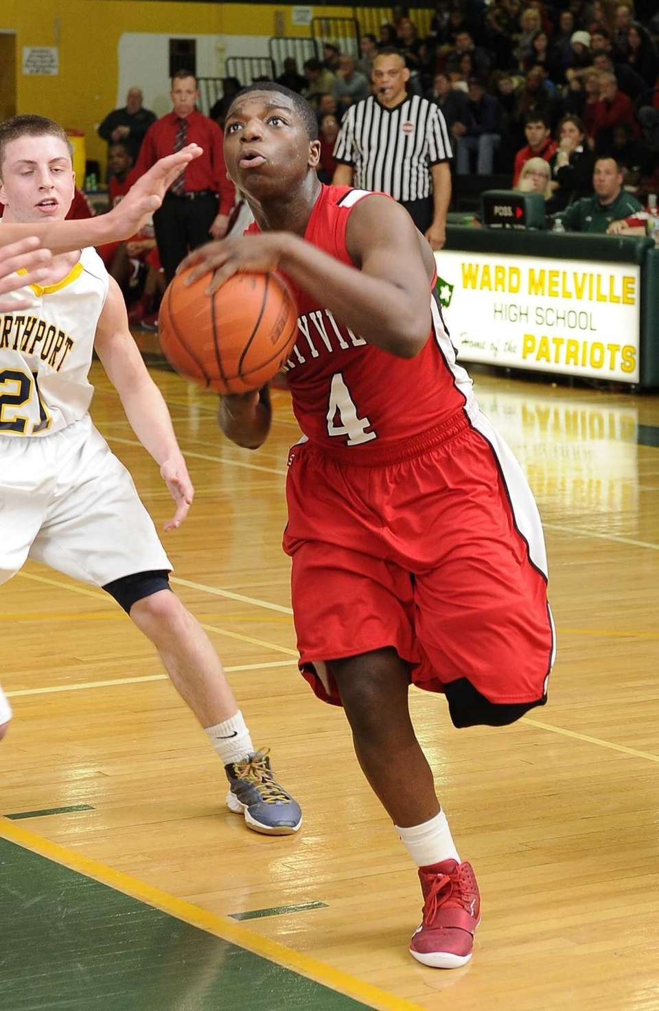 Amityville's Mike Alston drives in for a layup
