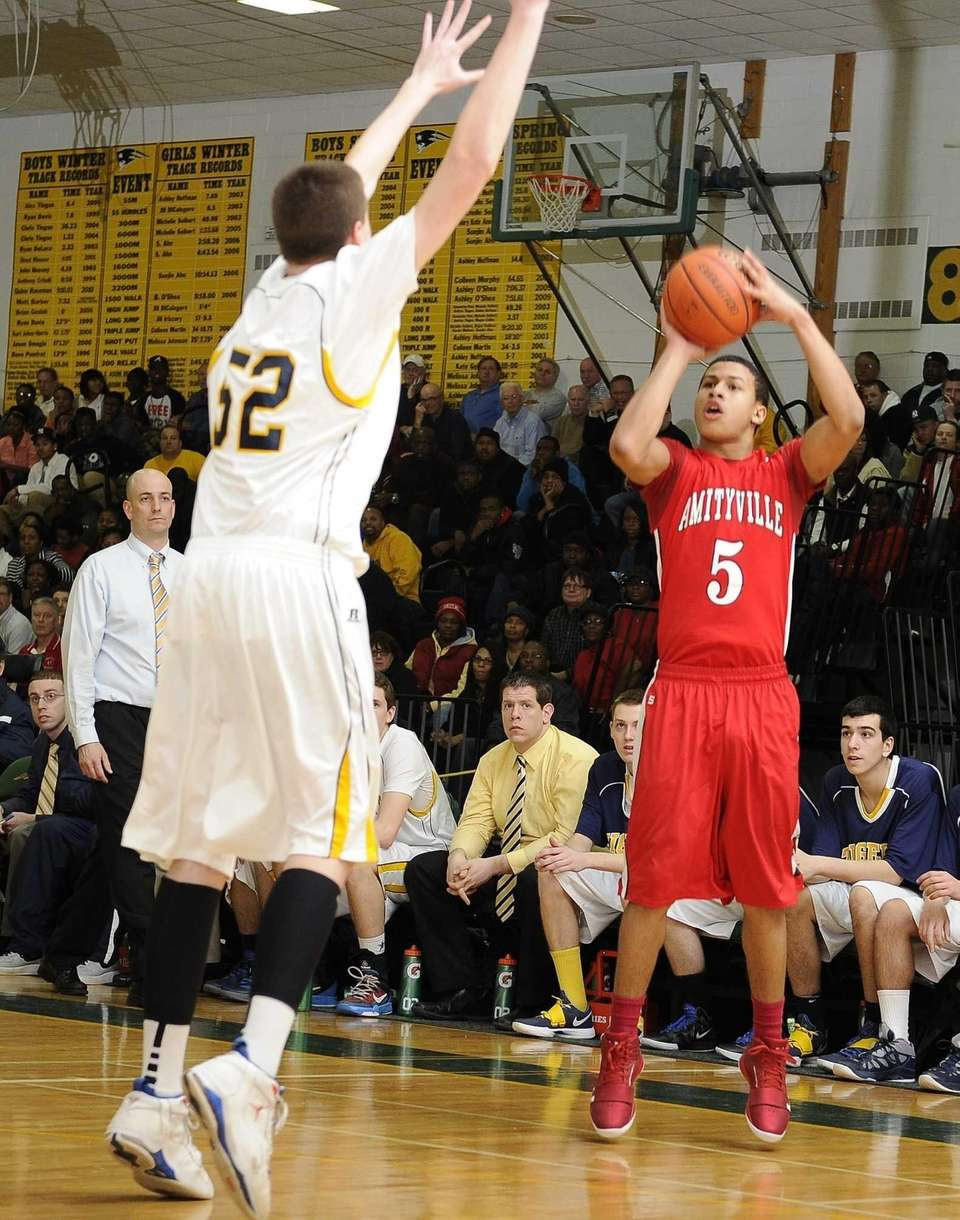 Amityville's Mike Smith shoots a three-point shot as