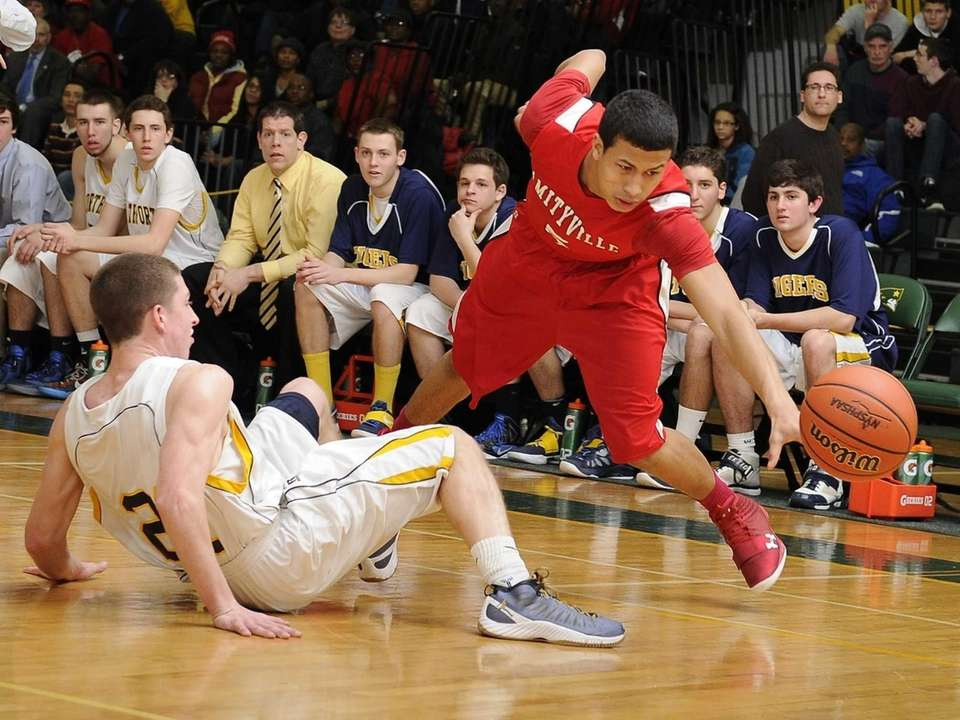 Amityville's Mike Smith is fouled by Northport's Austin