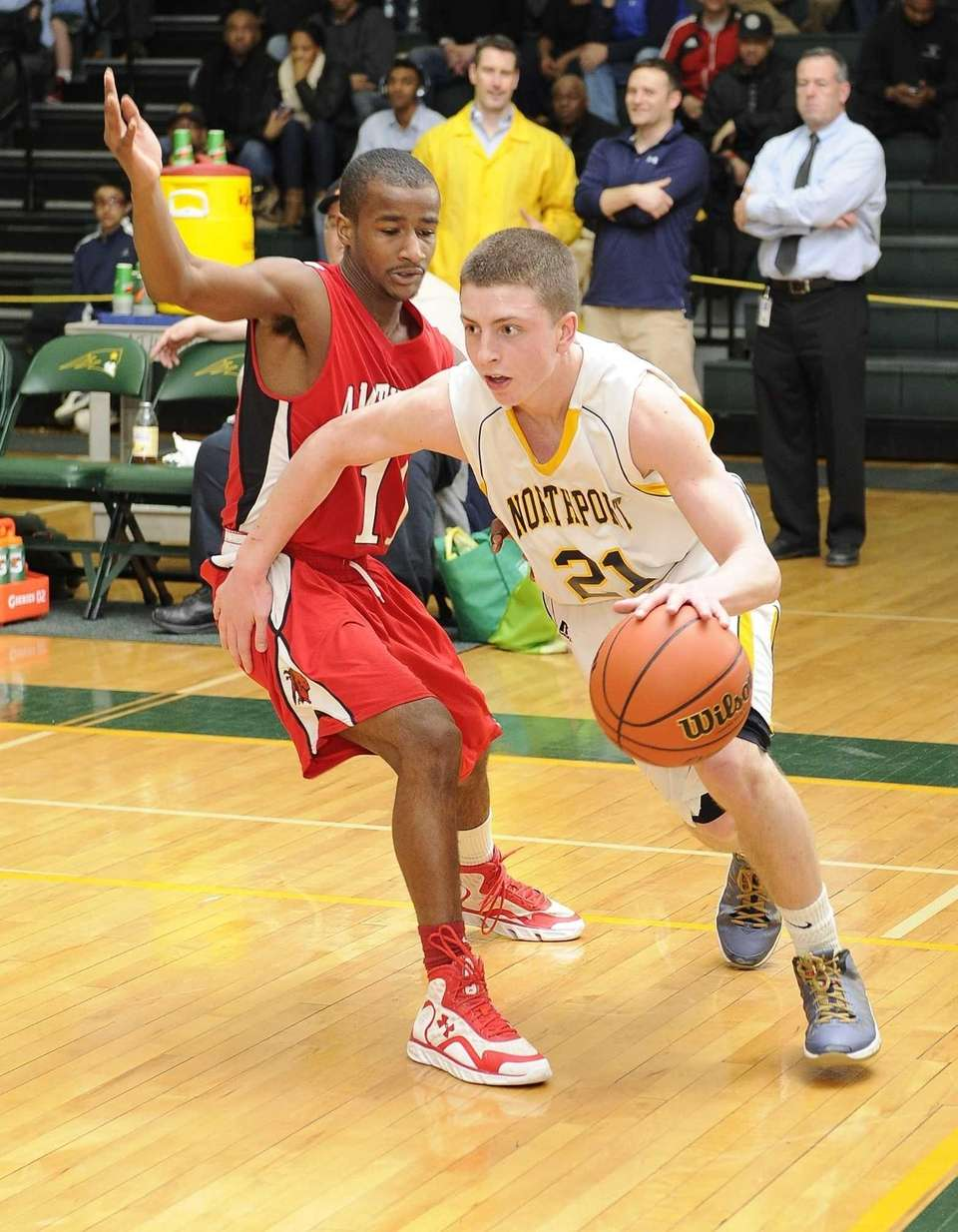 Northport's Austin Marchese drives past Amityville's Sean Walters
