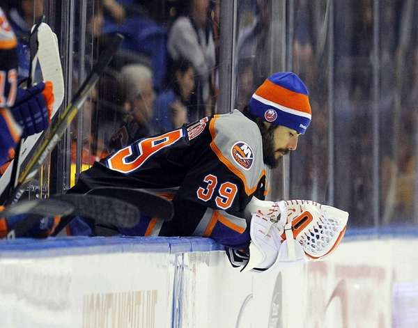 Rick DiPietro of the Islanders looks on from