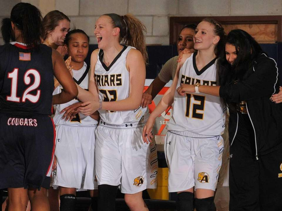 St. Anthony's Coulter Bowlen, center, and teammates celebrate