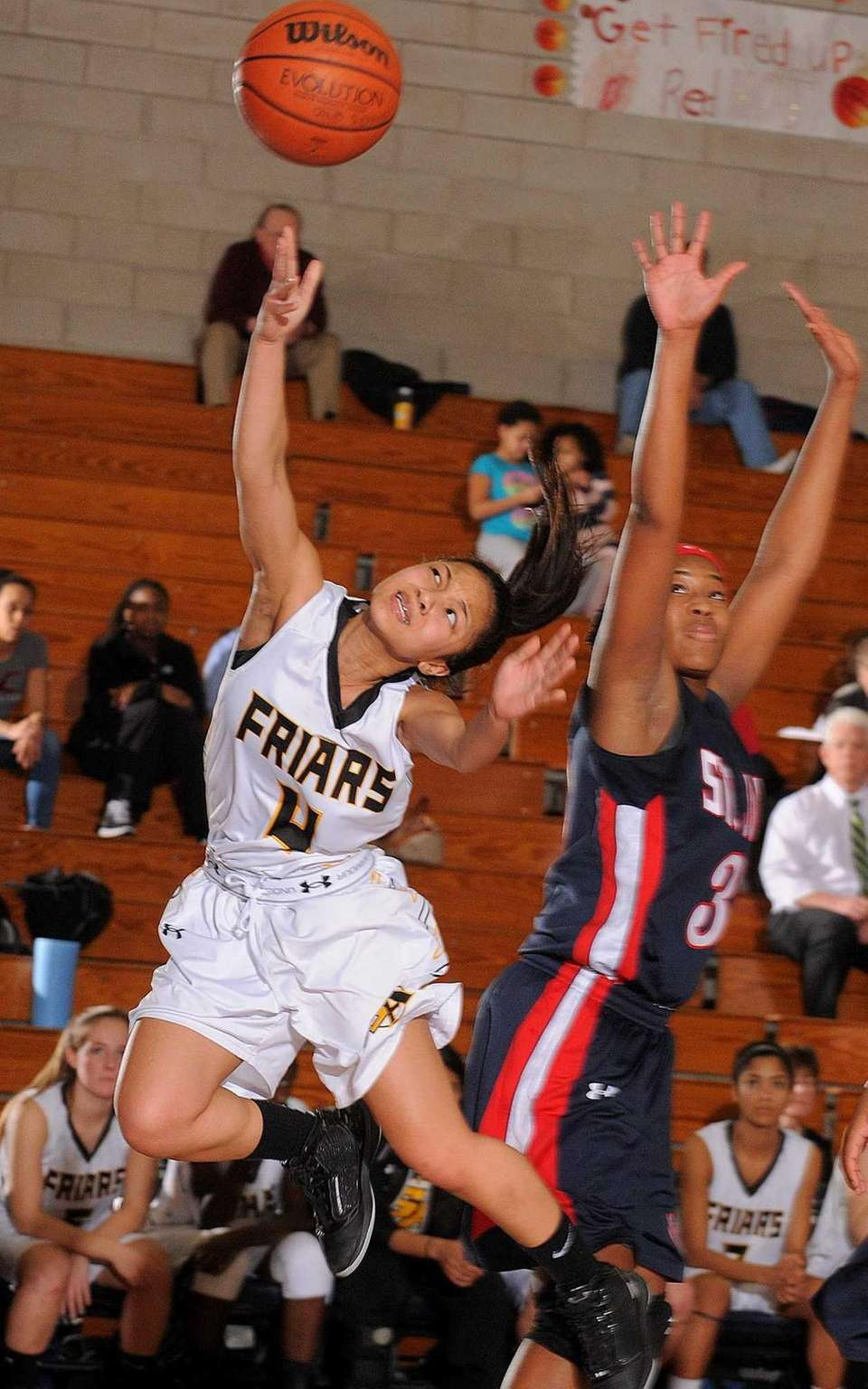 St. Anthony's Tyla Parham, left, looks to drive