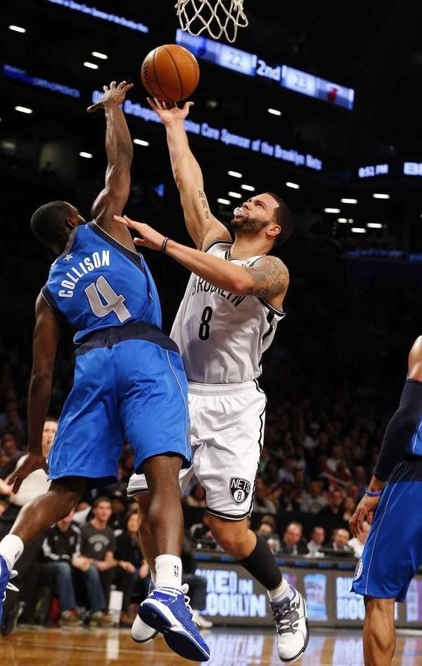 Deron Williams of the Nets goes to the