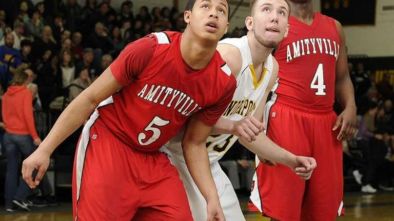 Amityville's Mike Smith boxes out Northport's Andrew Seaman