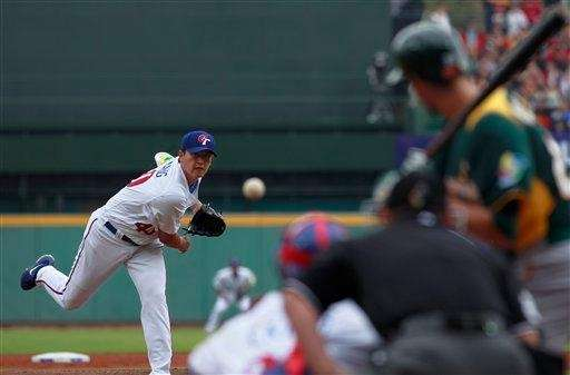 Taiwan's starter Wang Chien-ming delivers a pitch against