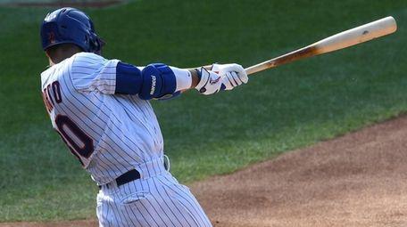 Mets rightfielder Michael Conforto doubles against the tlanta