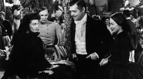 From left to right: Vivien Leigh, Clark Gable