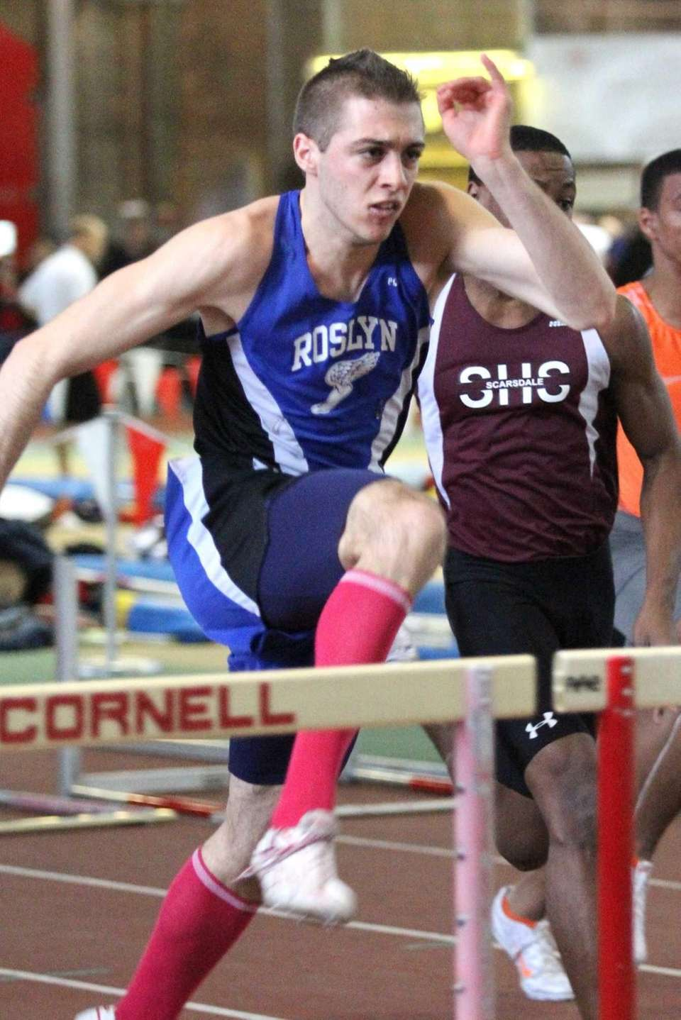 Roslyn's Luke Pascale clears the hurdle while winning