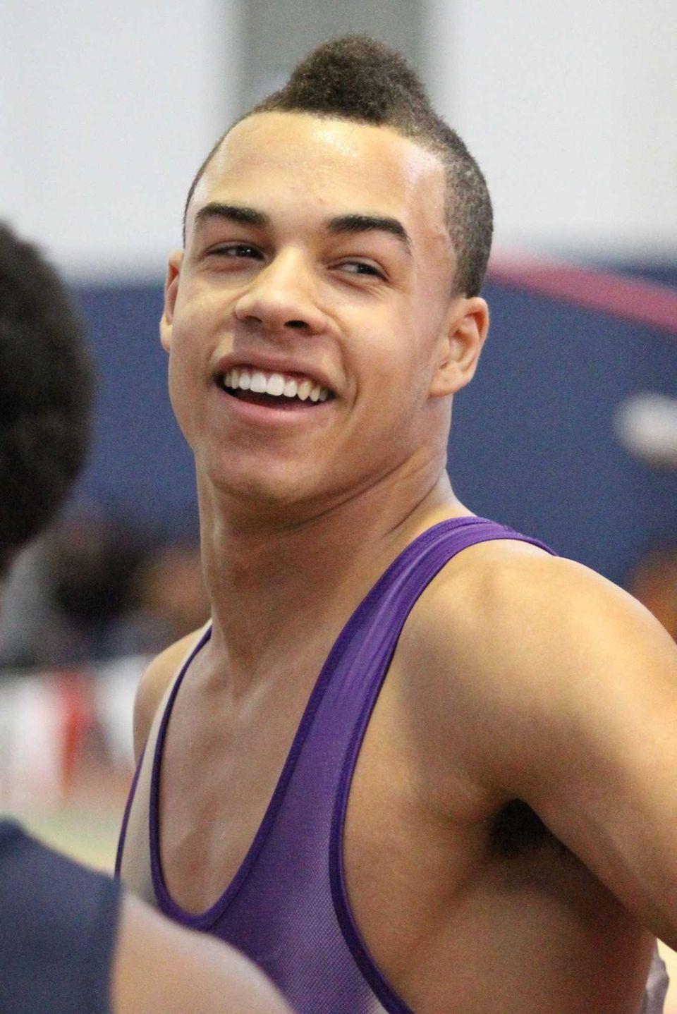 Sayville's Christopher Belcher celebrates his 55-meter dash win.