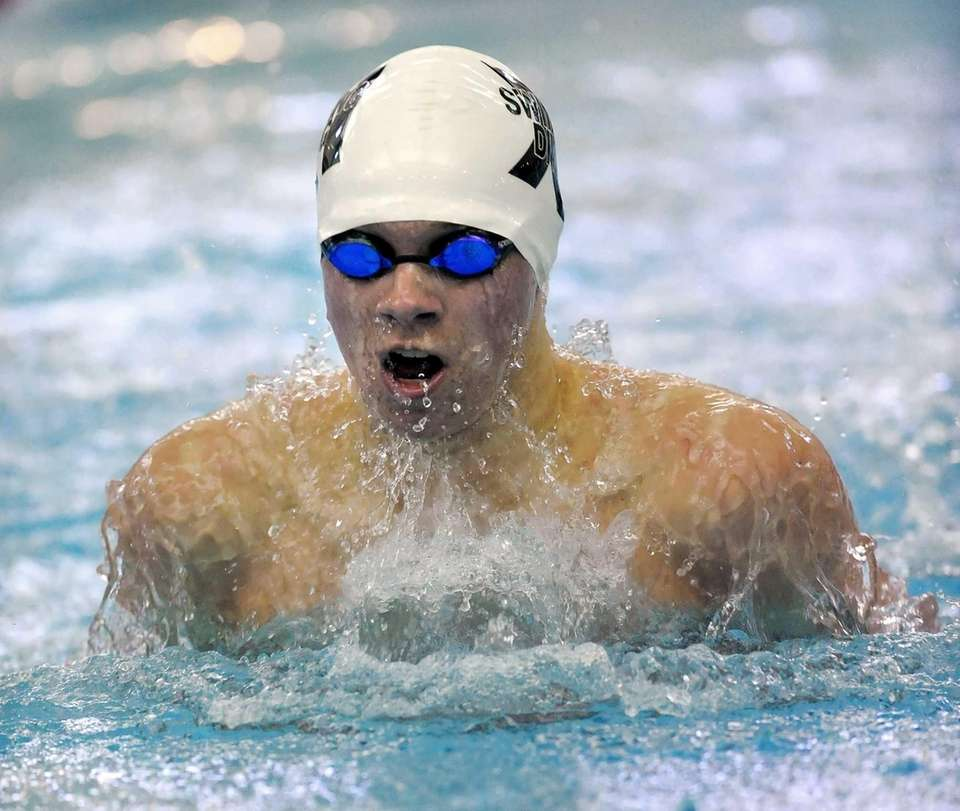Huntington's Gunther Cassell swims in the finals of