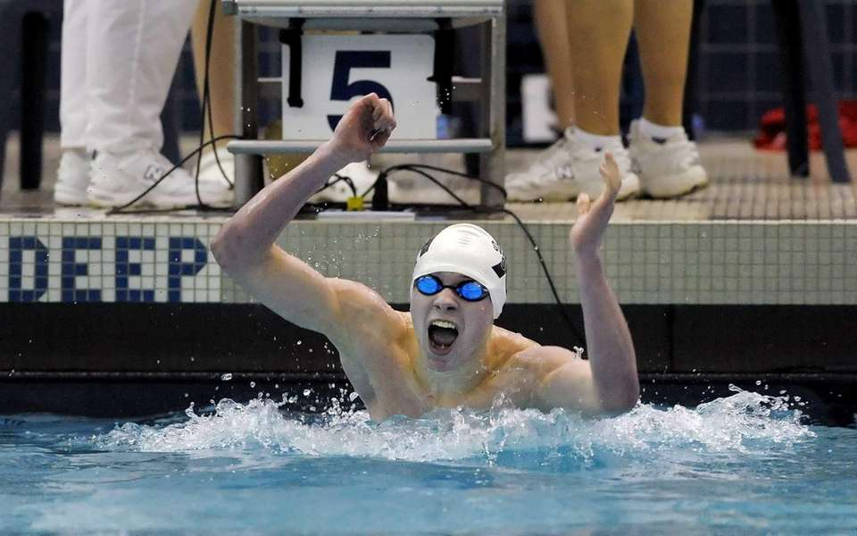 Huntington's Gunther Cassell celebrates his win in the