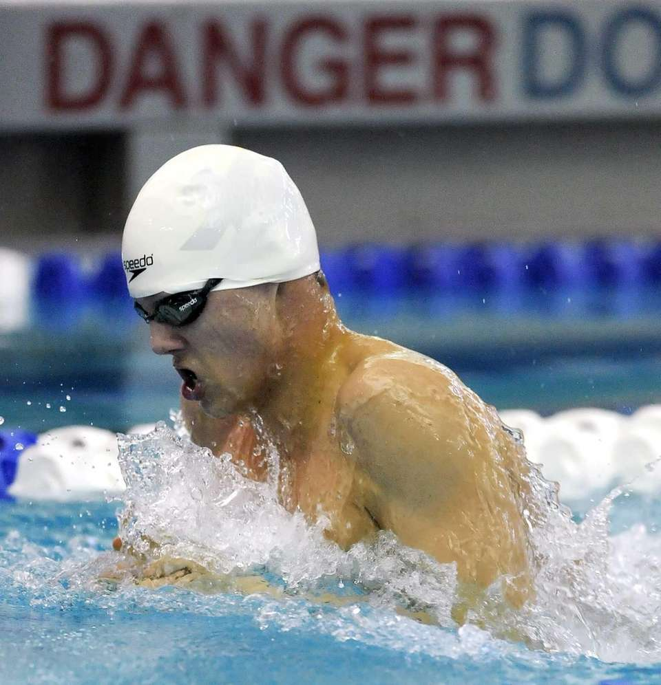 Smithtown's Ben Cono swims in the finals of
