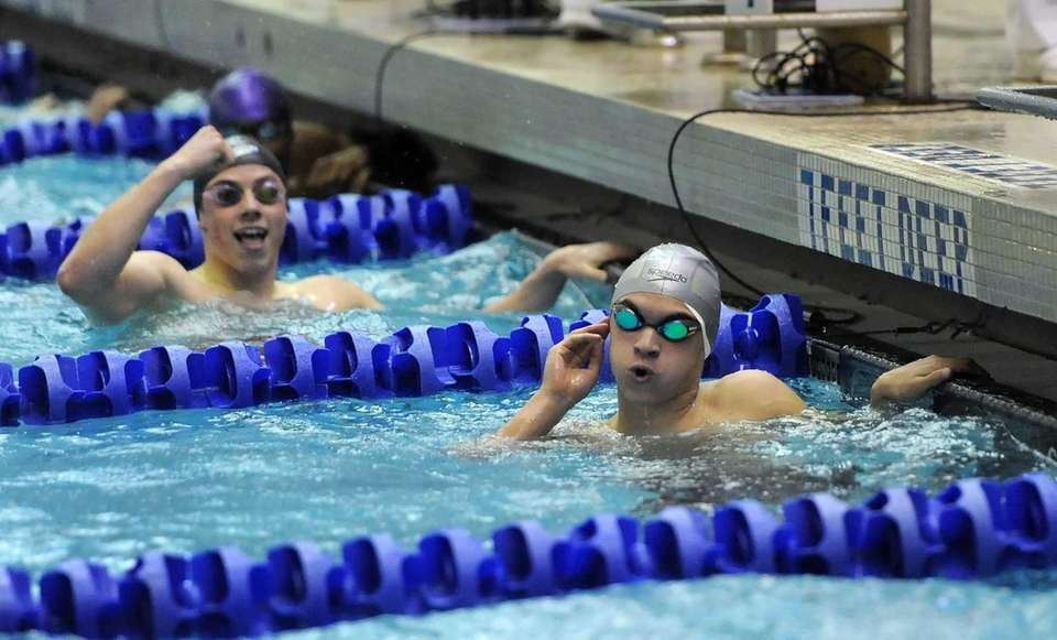 Hauppauge's Justin Plaschka, right, checks his time as