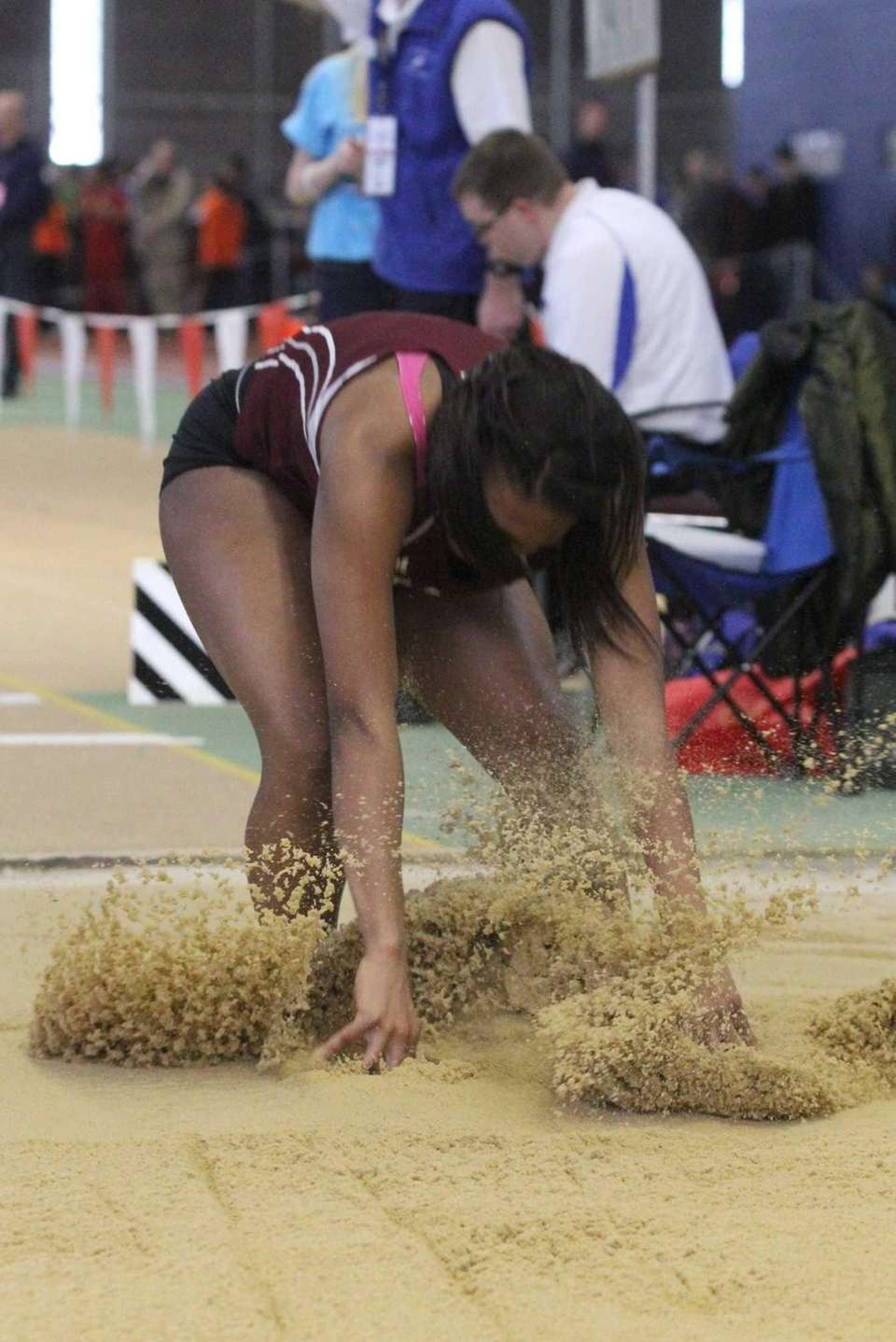 Bay Shore's Anisa Toppin lands during the first
