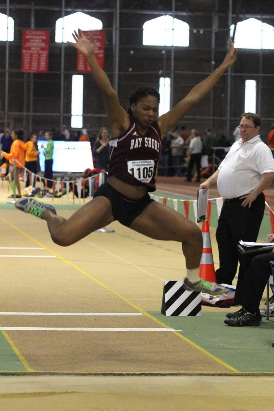 Bay Shore's Anisa Toppin leaps during the second